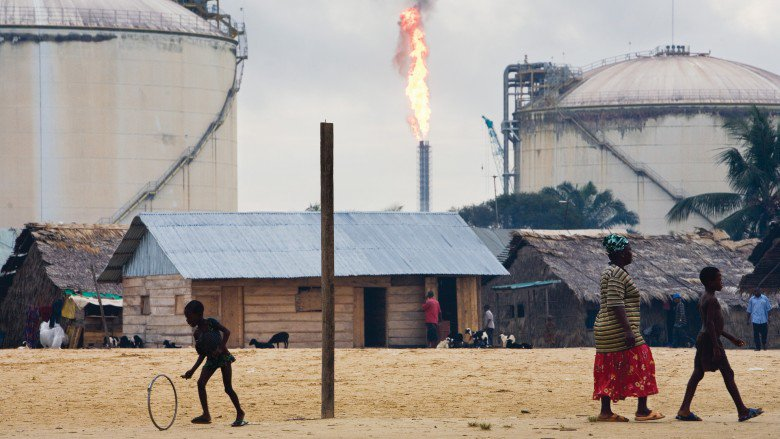 Flaring at a refinery alongside a local community