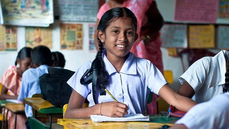 Une écolière en classe. © Banque mondiale